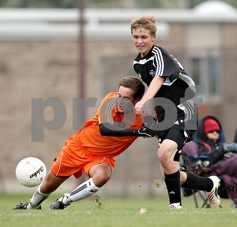Beck Diefenbach  -  bdiefenbach@daily-chronicle.com<br /> <br /> DeKalb's Joe Ferguson (8, left) slips around Kaneland's Trevor Wolf (16) during the second half of the game at DeKalb High School in DeKalb, Ill., on Monday Sept. 28, 2009.