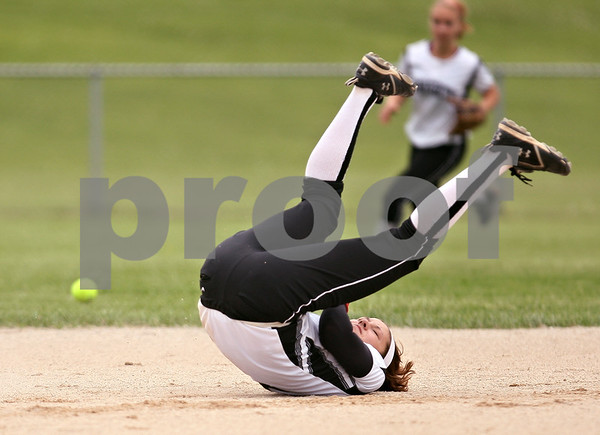 Beck Diefenbach  -  bdiefenbach@daily-chronicle.com<br /> <br /> Kaneland's Jessica Lubic (9) misses a ground ball during the second inning of the game against Hampshire at Burlington Central High School in Burlington, Ill., on Thursday May 28, 2009.