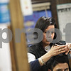 Beck Diefenbach  -  bdiefenbach@daily-chronicle.com<br /> <br /> Maria Caudillo, owner of Reyna's Peluqueria, cuts a patron's hair in her salon in downtown DeKalb, Ill., on Thursday Jan. 15, 2009.