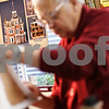 Beck Diefenbach  -  bdiefenbach@daily-chronicle.com<br /> <br /> The photo of what the doll house should look like hangs on the wall of Lee Newtson's work room at his Cortland, Ill., home on Monday Dec. 14, 2009. One of the doll houses will be delivered to the White House in Washington D.C. and the second will be sold to raise funds to benefit Fisher House which serves families of veterans at Hinds Veterans Affairs Hospital in Maywood, Ill.