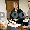 Beck Diefenbach  -  bdiefenbach@daily-chronicle.com<br /> <br /> Love Inc. volunteer David Ellison, center,  and executive director Nathan Scott, right discuss how to find help to fund a person in need in the new DeKalb office on Thursday May 14, 2009.