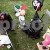 ROB WINNER | Chronicle News Group<br /> On Wednesday evening out on the lawn of the DeKalb County Courthouse, Roy Olson, of Sycamore, works on his family's Pumpkin Fest concept of the Grim Adventures of Billy and Mandy.<br /> 10/22/2008