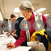 "Beck Diefenbach – bdiefenbach@daily-chronicle.com<br /> <br /> Corki Williams, of Sycamore, signs up for  exercise and nutrition classes after the first weigh-in for ""Weight No More,"" at Kishwaukee Hospital in DeKalb, Ill., on Monday March 2, 2009."