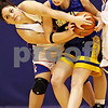 Beck Diefenbach  -  bdiefenbach@daily-chronicle.com<br /> <br /> Genoa-Kingston's Liana Beauchamp (32, left) ties to steal the ball from Somonauk's Lauren Brummel (35) during the third quarter of the game of the G-K Christmas Tournament at G-K High School in Genoa, Ill., on Tuesday Dec. 15, 2009.