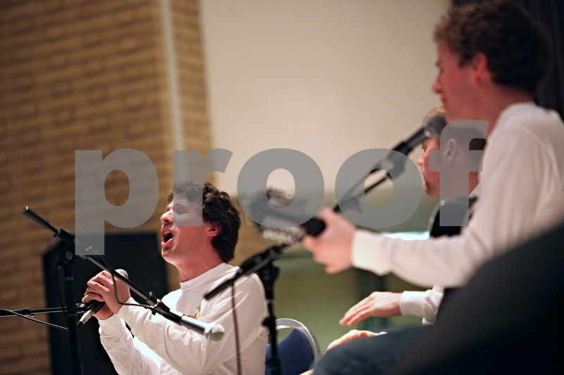 Beck Diefenbach  -  bdiefenbach@daily-chronicle.com<br /> <br /> Robert, left, and Scott Cerny, far right, perform during the memorial concert in the Holmes Student Center on the campus of Northern Illinois University in DeKalb, Ill., on Saturday Feb. 14, 2009.