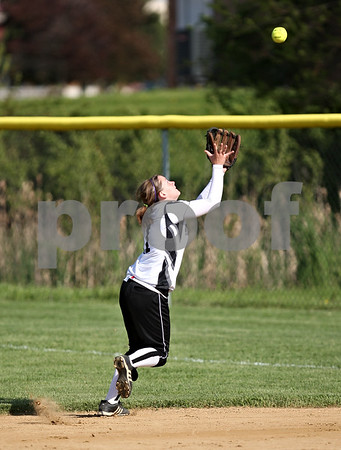 Beck Diefenbach  -  bdiefenbach@daily-chronicle.com<br /> <br /> Kaneland's Brittany Davis (11) catches a pop fly during the bottom of the first inning of the game against Sycamore High School at Sycamore High School in Sycamore, Ill., on Thursday May 14, 2009.