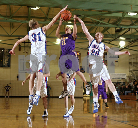 Beck Diefenbach  -  bdiefenbach@daily-chronicle.com<br /> <br /> Serena's Blake Chapman (11) shoots the ball between Hinkley-Big Rock's Ryan Korth (31) and Kyle Burks (20) during the second quarter of the game of the first round of the Little Ten Conference Basketball Tournament at Somonauk High School in Somonauk, Ill., on Monday Feb. 2, 2009.
