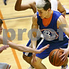 Beck Diefenbach  -  bdiefenbach@daily-chronicle.com<br /> <br /> Genoa's Nick Lopez protects the ball during practice at Genoa Kingston High School in Genoa, Ill., on Wednesday Jan. 7, 2009.