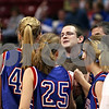 Beck Diefenbach – bdiefenbach@daily-chronicle.com<br /> <br /> Hinckley-Big Rock head coach Greg Burks meets with his players during the last timeout during the fourth quarter of the Class 1A IHSA State Basketball Championships against Winchester West Central at the Red Bird Arena in Normal, Ill., on Saturday Feb. 28, 2009.
