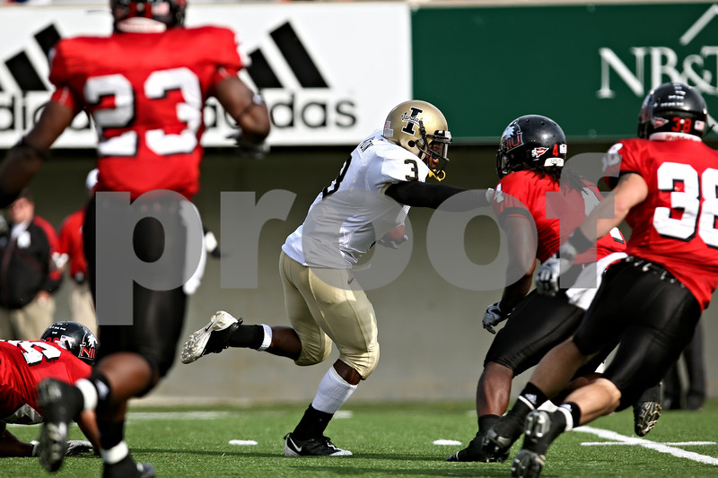 Rob Winner – rwinner@daily-chronicle.com<br /> Idaho's Deonte' Jackson barrels though the NIU defense for the Vandals' second touchdown in the first half.<br /> 09/26/2009