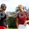 Rob Winner – rwinner@daily-chronicle.com<br /> NIU women's golf coach Pam Tyska (left) pats Jessica Parmenter on the back after giving her some advice on her swing recently at the Kishwaukee Country Club in DeKalb.<br /> 08/06/2009