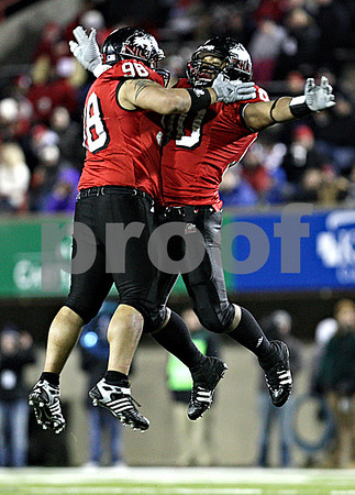 Rob Winner – rwinner@daily-chronicle.com<br /> D.J. Pirkle (left) and Alan Baxter celebrate a defensive stop in the second half.<br /> 11/12/2009