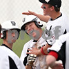 Beck Diefenbach  -  bdiefenbach@daily-chronicle.com<br /> <br /> Kaneland's Tyler Callaghan, center is congratulated after stealing home to end the game against Rochelle at Burlington Central High School in Burlington, Ill., on Thursday May 28, 2009.