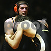 Beck Diefenbach  -  bdiefenbach@daily-chronicle.com<br /> <br /> DeKalb's Jake Bannister tangles with Sycamore's Christian Copple during the 215 weight class match at DeKalb High School in DeKalb, Ill., on Thursday Jan. 22, 2009.