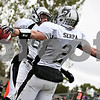 Rob Winner - rwinner@daily-chronicle.com<br /> <br /> Ryley Bailey and Blake Serpa celebrate Serpa's second touchdown in the first quarter.<br /> <br /> 10/10/2009