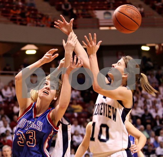 Beck Diefenbach – bdiefenbach@daily-chronicle.com<br /> <br /> Hinckley-Big Rock forward Tess Godhardt (33) and Ridgeview guard Paige Nord (10) scramble for a loose ball during the third quarter of the Class 1A Girls Basketball Semi-Final game at the Red Bird Arena in Normal, Ill., on Friday Feb. 27, 2009.
