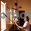 Beck Diefenbach  -  bdiefenbach@daily-chronicle.com<br /> <br /> Aaron Westlund lays down a coat of paint with the rest of his team from Target inside the theater at Conexión Comunidad as part of the city-wide United Way event, Day of Caring, in DeKalb, Ill., on Thursday Sept. 10, 2009.