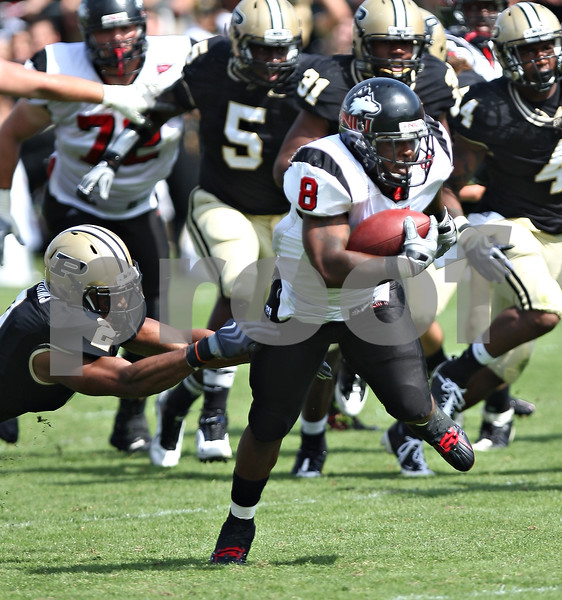 Beck Diefenbach – bdiefenbach@daily-chronicle.com<br /> <br /> Northern Illinois' Me'co Brown (8) rushes with ball during the first half of the game against Purdue University in West Lafayette, Ind., on Saturday Sept. 19, 2009