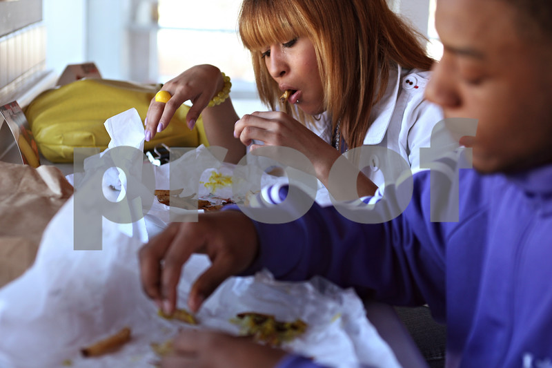"""Beck Diefenbach  -  bdiefenbach@daily-chronicle.com<br /> <br /> Northern Illinois University students Brittany Watson and her boyfriend William Kennedy eat hot dogs and french fries at the new F and J's restaurant on Annie Glidden Road in DeKalb, Ill., on Monday March 16, 2009. """"(F and J's) is the cheapest around,"""" Watson said. """"I wanted a piece of pizza, but now it's too expensive,"""""""