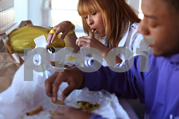 "Beck Diefenbach  -  bdiefenbach@daily-chronicle.com<br /> <br /> Northern Illinois University students Brittany Watson and her boyfriend William Kennedy eat hot dogs and french fries at the new F and J's restaurant on Annie Glidden Road in DeKalb, Ill., on Monday March 16, 2009. ""(F and J's) is the cheapest around,"" Watson said. ""I wanted a piece of pizza, but now it's too expensive,"""