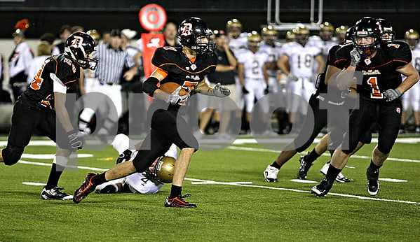 Rob Winner rwinner@daily-chronicle.com<br /> DeKalb's Dylan Donnelly makes his second interception as time expires in the first half. <br /> 09/11/2009