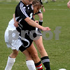 Rob Winner – rwinner@daily-chronicle.com<br /> Indian Creek's Katie Hunt tries to move the ball past a Kaneland defender in the first half of their game in Maple Park on Thursday. Kaneland defeated Indian Creek 2-0.                                       <br /> 04/23/2009