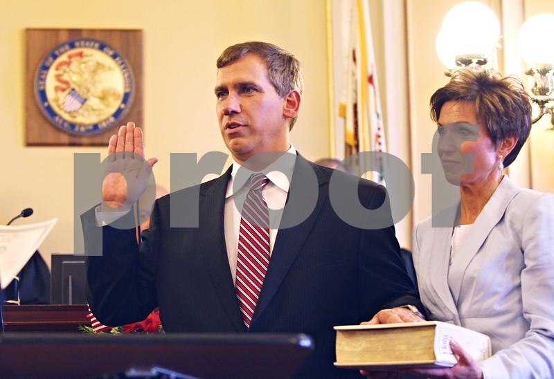Beck Diefenbach  -  bdiefenbach@daily-chronicle.com<br /> <br /> Associate Judge Ron Matekaitis is sworn in with help from his wife Leslie at the DeKalb County Court House in Sycamore, Ill., on Friday May 1, 2008.