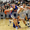Rob Winner – rwinner@daily-chronicle.com<br /> Rob Winner – rwinner@kcchronicle.com<br /> Glenbard South's Dan Marshall (left) and Dave Dudzinski chase after a loose ball during the first half of Tuesday night's game.<br /> 12/01/2009