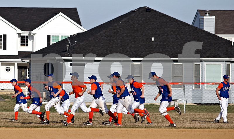 Beck Diefenbach  -  bdiefenbach@daily-chronicle.com<br /> <br /> The Genoa Kingston baseball team runs sprints following their 16-0 loss to Burlington Central at GK High School in Genoa, Ill., on Friday April 17, 2009.