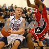 Rob Winner – rwinner@daily-chronicle.com<br /> Genoa-Kingston's Scott Suchy drives to the basket while being pressured by Yorkville defender Jordan Jones during the first half of their game on Monday December 28, 2009 in Plano, Ill.