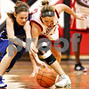 Beck Diefenbach  -  bdiefenbach@daily-chronicle.com<br /> <br /> Newark's Lauren Tollefson (11, left) and Indian Creek's Carson Day (20) fight for the ball during the first half of the game at Indian Creek High School in Shabbona, Ill., on Monday Nov. 30, 2009. Newark defeated Indian Creek 59 to 40.