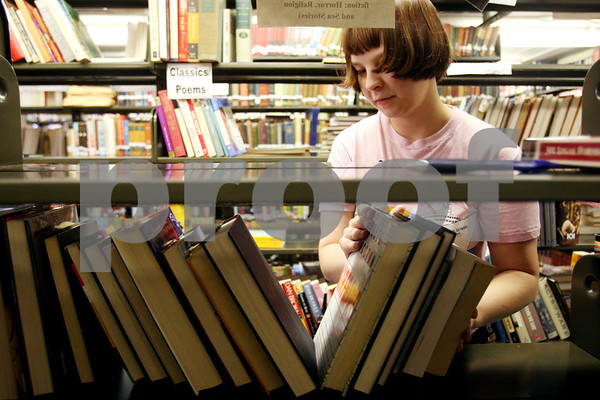Rob Winner rwinner@daily-chronicle.com<br /> Jennifer Allen, of the DeKalb Library, helps shelf books that were donated for the 6th annual Friends of the Library Book Sale which begins September 18.<br /> 09/10/2009