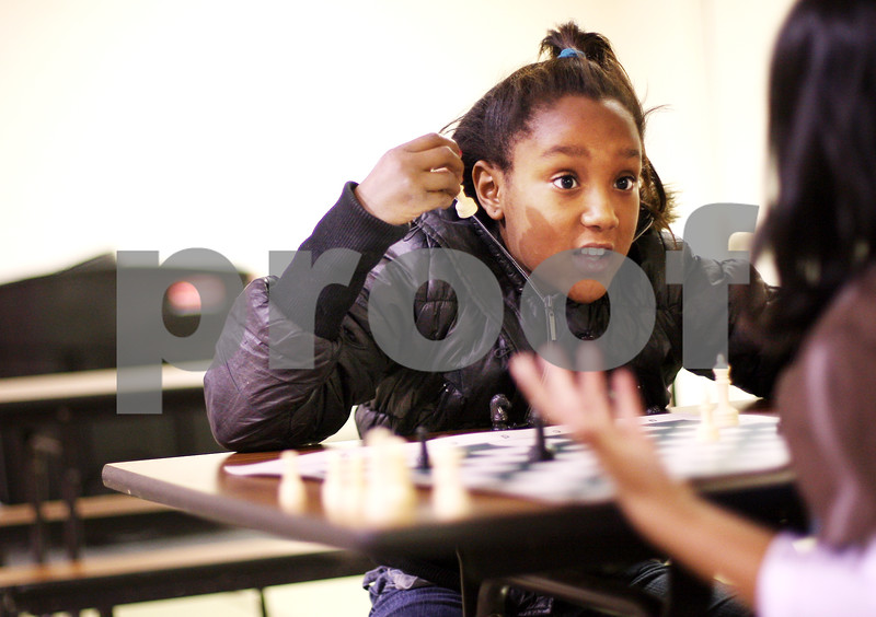 Beck Diefenbach  -  bdiefenbach@daily-chronicle.com<br /> <br /> Third grader A'jah Davis disputes a move with her opponent during chess club at Tyler Elementary School in deKalb, Ill., on Monday Dec. 7, 2009.