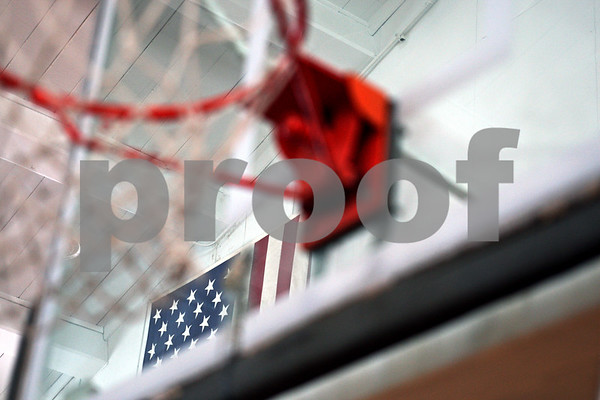Beck Diefenbach – bdiefenbach@daily-chronicle.com<br /> <br /> The American flag hangs on the wall behind one of the basketball hoops in the Sycamore Armory in Sycamore, Ill., on Wednesday March 11, 2009.