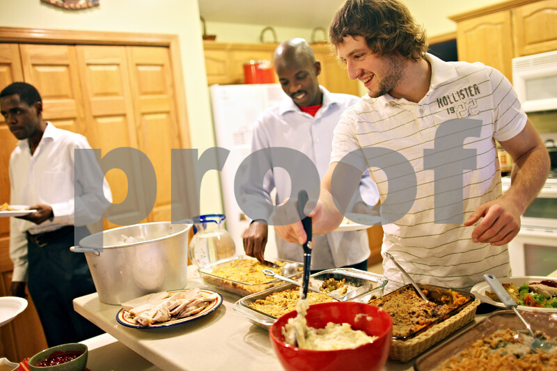 Beck Diefenbach  -  bdiefenbach@daily-chronicle.com<br /> <br /> Valentine Goncharenko, of Ukraine, serves himself some mashed potatoes during a Thanksgiving dinner for international students at the Riley's home in Sycamore, Ill., on Thursday Nov. 26, 2009.