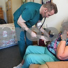 Beck Diefenbach  -  bdiefenbach@daily-chronicle.com<br /> <br /> Elaine Davis, 81, has her blood pressure measured by Registered Nurse Gary Ketchum during a home health visit check up at Davis' apartment at Barb City Manor in DeKalb, Ill., on Thursday Feb. 5, 2009.