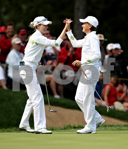 Beck Diefenbach  -  bdiefenbach@daily-chronicle.com<br /> <br /> Europe's Diana Luna, left, and Catriona Matthew celebrate after finishing the 7th hole against team USA at the Solheim Cup in Sugar Grove, Ill., on Saturday Aug. 22, 2009.
