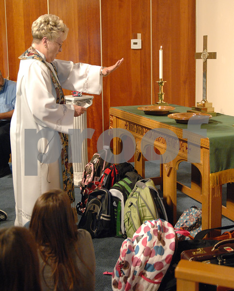 Pastor Sandra Graber blesses a group of backbacks during the Blessing of the Backbacks at the Waterman Presbyterian Church on Sunday, September 13, 2009 in Waterman.(Marcelle Bright/for the Chronicle)