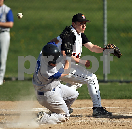 Beck Diefenbach  -  bdiefenbach@daily-chronicle.com<br /> <br /> Geneva's Brian Cornick (9) recoils from being hit in the head with the ball missed by DeKalb pitcher Ben Dallesasse (14) during the top of the second inning of the game at Dekalb High School in DeKalb, Ill., on Tuesday May 12, 2009.