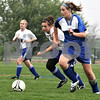 Randi Stella – rstella@daily-chronicle.com<br /> <br /> Genoa's Britni Michael (9)  and Westminster's Rachel Doby (10) battle for the ball at the regional quarter final at Genoa-Kingson High School in Genoa, Ill., on Wednesday May 13th, 2009.