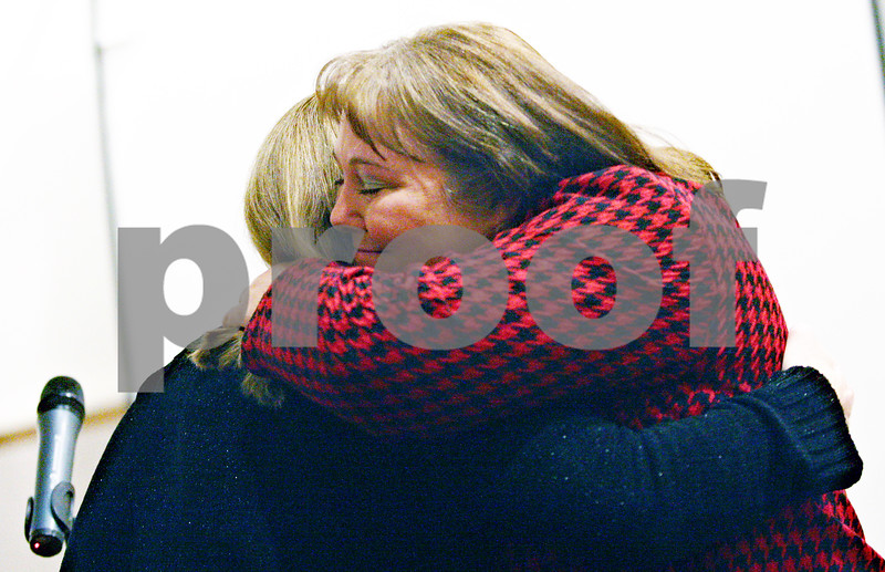 Beck Diefenbach  -  bdiefenbach@daily-chronicle.com<br /> <br /> DeKalb County Public Defender Regina Harris (right) embraces drug court graduate Deborah (CQ no last names allowed) during the graduation ceremony at the Legislation Building in Sycamore, Ill., on Friday Jan. 9, 2009.