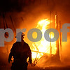 Beck Diefenbach  -  bdiefenbach@daily-chronicle.com<br /> <br /> A firefighter watches as a blaze destroys the units at 1563 W Stonehenge Dr. Sycamore, Ill., on Wednesday Jan. 7, 2009.