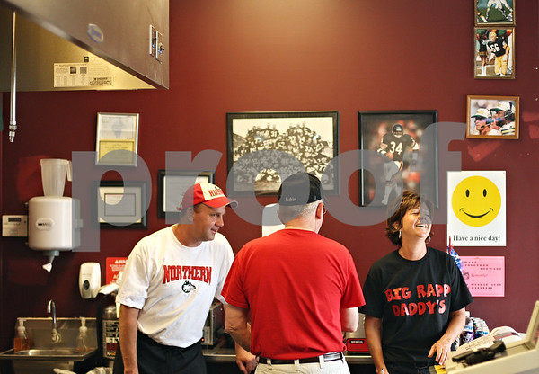 Beck Diefenbach  -  bdiefenbach@daily-chronicle.com<br /> <br /> Doug Rapp, left, and Dawn Roberts share a laugh with their father Duane, center, while taking a break from serving up hamburgers at their new restaurant Big Rapp Daddy's in DeKalb, Ill., on Tuesday May 26, 2009.