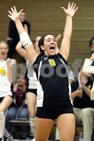 Chronicle photo KATE WEBER<br /> Sycamore's Justine Schepler celebrates the Spartan's victory over Metamora Monday night in the IHSA SuperSectional girls' volleyball match at Galesburg.