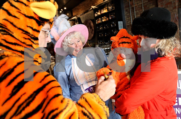 Beck Diefenbach  -  bdiefenbach@daily-chronicle.com<br /> <br /> Michelle Brokop, far right, helps her nephew Michael Francis McGinnis, 2, tick or treat for candy from Steve Johnson, far left, and his wife Sue at Tapalaluna in DeKalb, Ill., on Saturday Oct. 31, 2009.