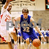 Beck Diefenbach  -  bdiefenbach@daily-chronicle.com<br /> <br /> Geneva's Scott Wendt (32, right) dribbles past Rockford Jefferson's Eric Hollilns (23) during the first quarter of the game at DeKalb High School in DeKalb, Ill. on Wednesday Dec. 23, 2009.