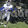 Rob Winner – rwinner@daily-chronicle.com<br /> <br /> Sycamore defenders try to wrap up Glenbard South quarterback Trace Wanless during the first half.<br /> <br /> 10/23/2009