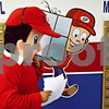 Beck Diefenbach  -  bdiefenbach@daily-chronicle.com<br /> <br /> Javier Valencia, an employee for Going Postal, walks past the cartoon version of the costume he is wearing as the new company's mascot before distributing flyers in Sycamore, Ill., on Wednesday March 18, 2009.