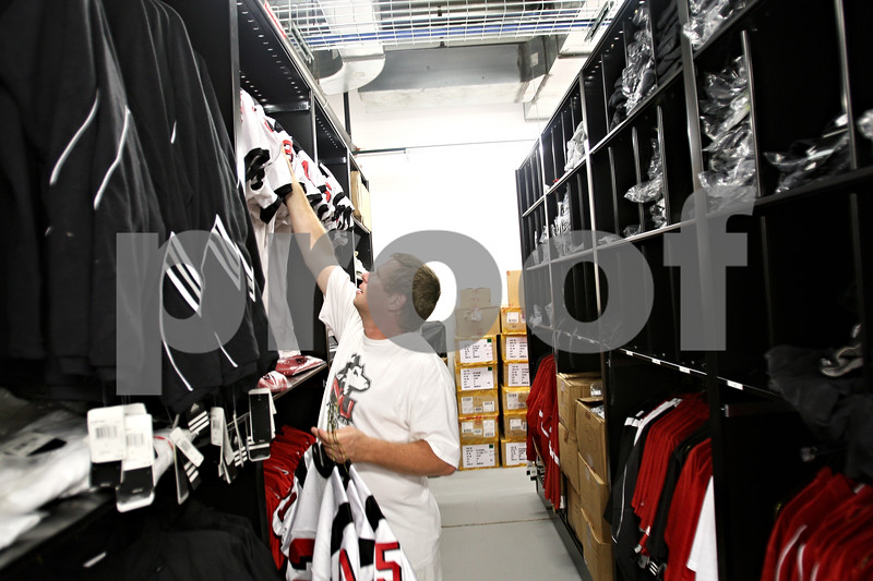 Beck Diefenbach  -  bdiefenbach@daily-chronicle.com<br /> <br /> Northern Illinois football equipment manager Alvy Armstrong hangs jersey's between football practices on Wednesday Aug. 19, 2009.
