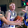 Beck Diefenbach  -  bdiefenbach@daily-chronicle.com<br /> <br /> Hinckley Big-Rock's Brian Michaels (12) gets caught in the middle of Somonauk's Zach McQuate (55) and Nick Gottlieb (5) during the second quarter of the game at HBR High School in Hinckley, Ill., on Tuesday Jan.. 20, 2009. Somonauk beat HBR 80 to 67.